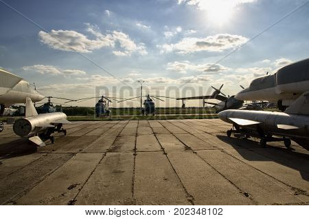 Military airport with a lot of aircraft and nuclear bombs