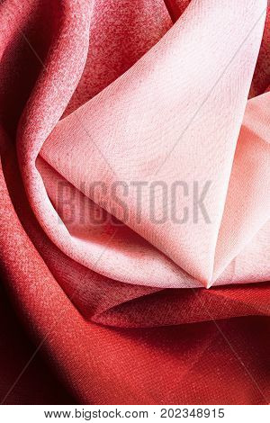Abstract draped red and pink silk as a background