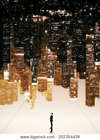 Tiny businessman on abstract upside down city background. Pensive concept