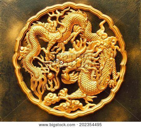 Detail of circular a golden dragon medallion