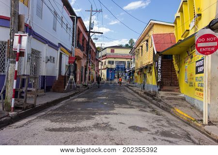 PORT ANTONIO, JAMAICA - JANUARY 1: Unidentified people walking on the colorful streets of downtown Port Antonio on New Year's Day morning January 1, 2014 in Port Antonio, Jamaica.