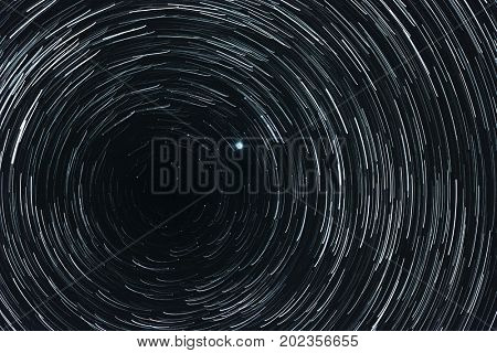Collage of starry sky with trails and Polar star in the center