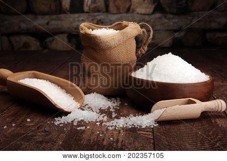 Sea Salt In Bowl. Crystals Of Salt On Table