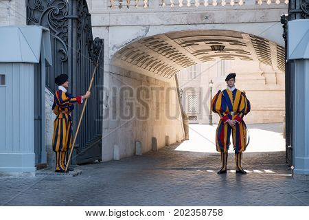 VATICAN CITY,ITALY - JULY 19, 2017 : Soldiers of the Pontifical Swiss Guard standing next to Saint Peter's Square at the Vatican