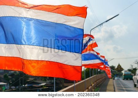 Close Up Thai Flags On The Pole Blown By Wind In Sunny And Cloudy Day.