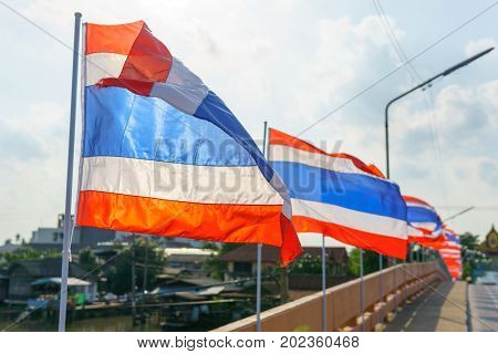 Close Up. Thai Flags On The Pole Blown By Wind At The Bridge.