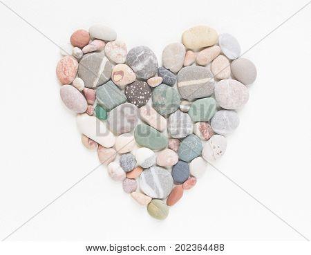 Sea pebbles stones heart. Sea pebbles background