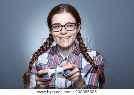 Nerd Woman with Braid Playing Videogames with a Joypad poster