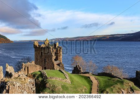 Beautiful sun drenched view of Urquhart Castle Ruins and Loch Ness in the Autumn or early winter.