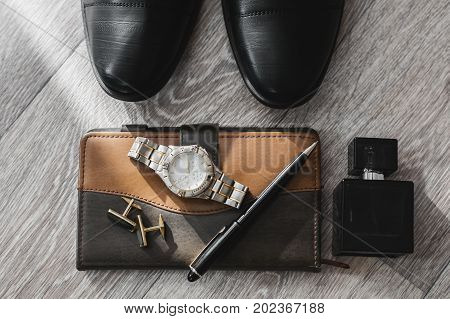 Businessman accessories. Man's style. Shoes with notepad