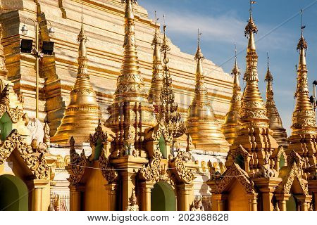 A detail of the golden stupa of the buddhist Shwedagon Paya the most famous landmark of the city of Yangon in Burma