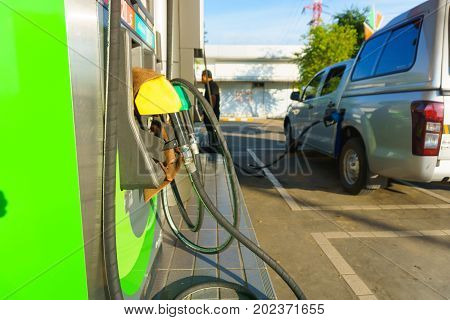 Car Waiting For Fill Fuel With Petrol Pump Nozzle At Gas Station In Sunny Day Before Gas Price Is Up