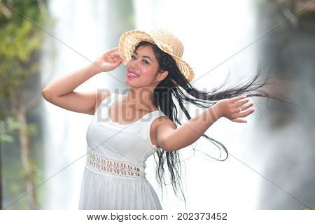 A pretty Asian woman jerking her hair.