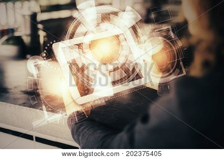 Woman using tablet computer with digital business hologram. Innovation concept. Double exposure