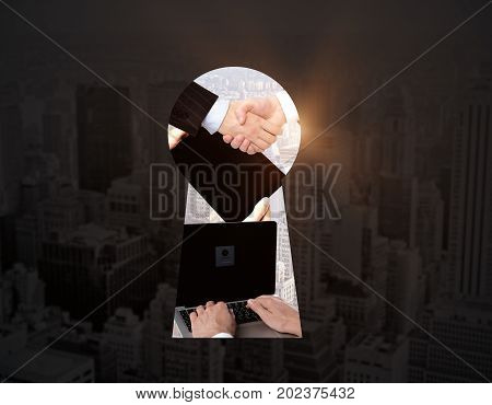 Abstract keyhole opening with handshake other objects and sunlight on city background. Collaboration concept