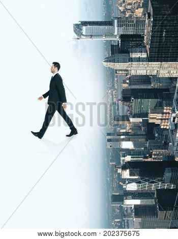 Side view of running businessman on abstract white upside down city background. Future concept