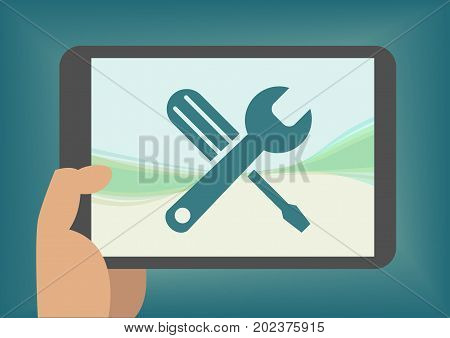 Concept of mobile app development toolbox with hand holding tablet