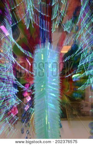 Abstract of zoom in or zoom out long exposure a colorful ribbon decorated a party at night.