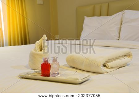 Bathroom Accessories Preparation On The Bed In A Room Of Hotel Or Apartment. Well And Nice Preparati