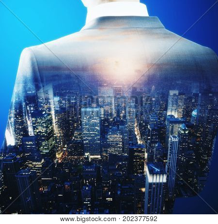 Back view of young businessman on abstract city background. Tomorrow concept. Double exposure