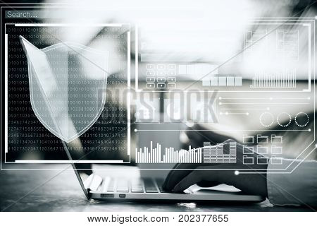 Side view of hands using laptop with digital antivirus interface. Toned image. Ecryption concept. Double exposure