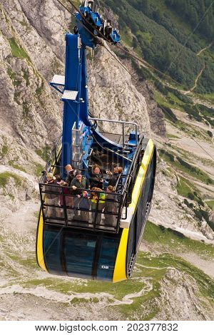 Ramsau Am Dachstein, Austria - August 17: Tourists On Top Of Gondola In The Upper Station Of The Dac