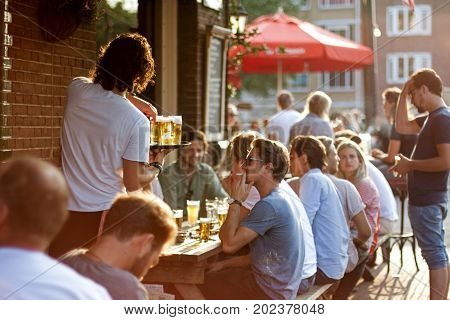 Amsterdam, Netherlands. July 19, 2017. Young friends hanging out together in the Amsterdam cafe