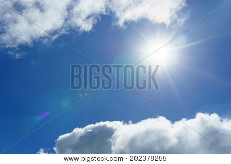 blue sky with clouds and sun for background. sun light shining over the clear sky and clouds. Beautiful and Amazing azure sky with clouds and sunshine for background