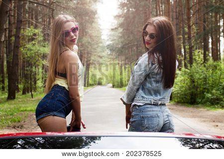 two cool girls having fun in cabrio