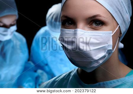 Medical team performing operation. Focus at female doctor. Medicine and health care