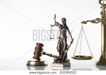 Law symbols - gavel, scale and statue of justice isolated on white background.