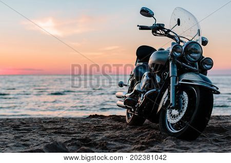 Motorcycle chopper against the sea. Outdoors photo. poster