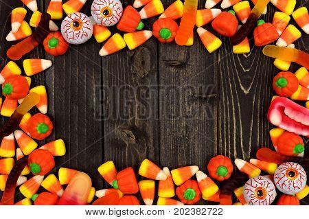 Halloween Candy Frame Over A Dark Black Wood Background