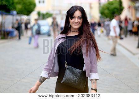 young pretty brunette girl urban dinamic portrait