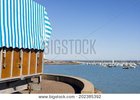 An invitation to the harbour of Jard Sur Mer in Vendee France on a sunny day in summer.