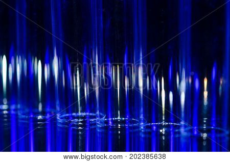 Abstract: Vertical Streaks of Blue and White Light Forming a Fascinating Background