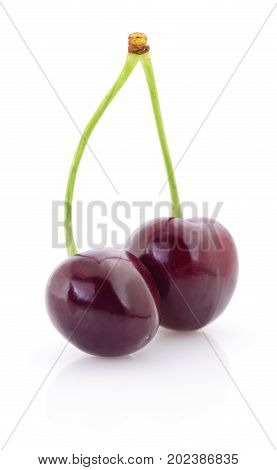 Two Sweet Cherry with stem on white background
