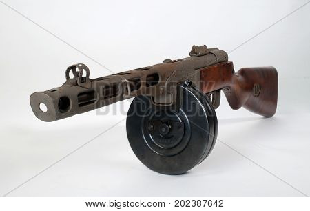 submachine gun ppsh-41 on a light background. View front left.