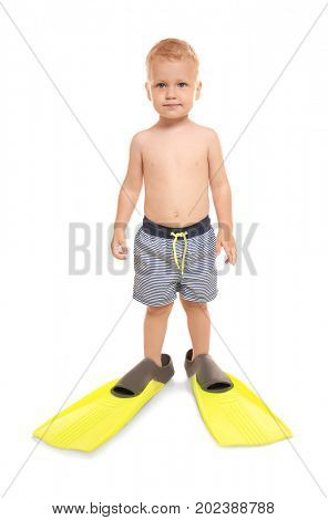 Cute little boy in blue striped swim trunks wearing bright yellow flippers isolated on white