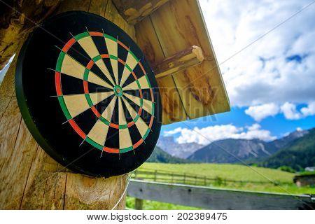 empty dartboard outdoor wooden stand sport activity