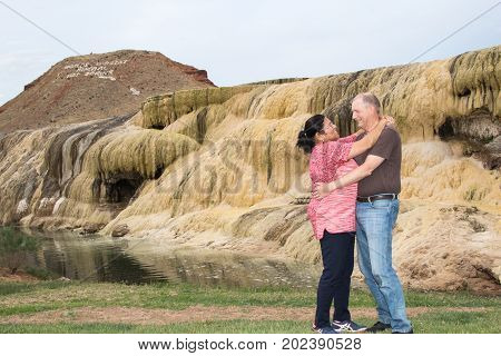 A happy couple at a geothermal terrace in Hot Springs State Park, Thermopolis, Wy