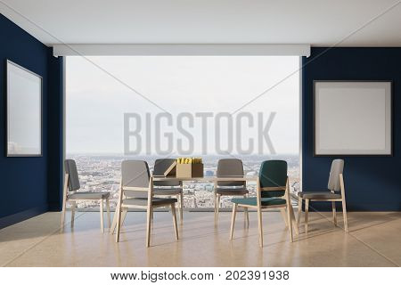Blue dining room interior with long wooden and glass table blue and gray chairs two framed square posters and loft windows. 3d rendering mock up