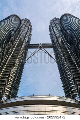 KUALA LUMPUR, MALAYSIA - August 30: The Famous Petronas Twin Towers in Malaysia on August 30, 2017 in Kuala Lumpur. Petronas Twin Towers are twin skyscrapers and were tallest buildings in the world from 1998 to 2004.