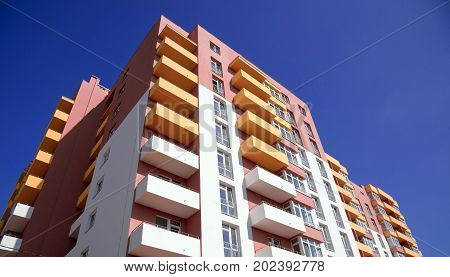 Apartment Building On Blue Sky Background