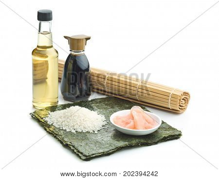 The sushi ingredient. Nori, rice, rice vinegar, pickled ginger and soy sauce isolated on white background.