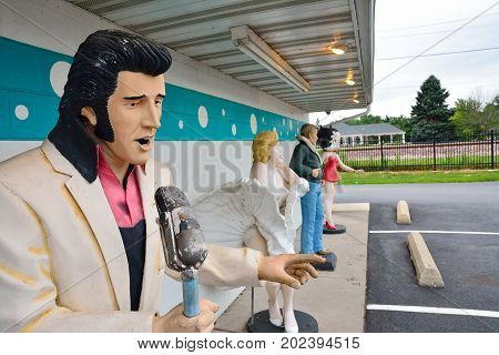 Statues Of Elvis Presley, Marilyn Monroe, James Dean, And Betty Boop.