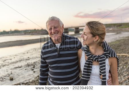 A Senior Man With Adult Daughter At Sea