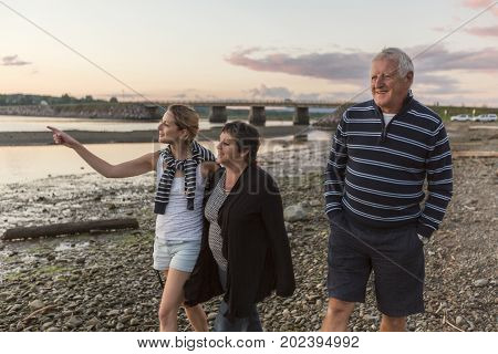 A Senior father and mother With Adult Daughter At Sea