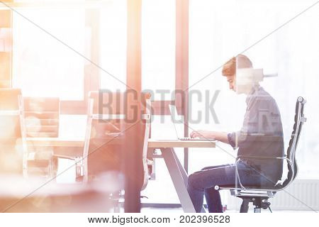 Businessman at the work in his bright office trying to resolve problem