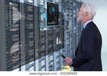 Portrait of senior businessman in big rack server room